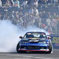 Drivers compete in the FIA Intercontinental Drifting Cup in Tokyo's Odaiba district on Sunday. | YOSHIAKI MIURA