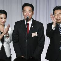 Former Democratic Party chief Renho (left), current President Seiji Maehara (center) and Yukio Edano, who announced Monday plans to establish a new party ahead of the Oct. 22 Lower House election, appear together Sept. 1 after Maehara was elected new DP leader. | KYODO