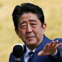 Prime Minister Shinzo Abe, who is also leader of the ruling Liberal Democratic Party, attends a campaign rally in the city of Fukushima. | REUTERS