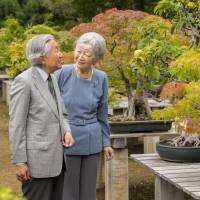 Empress Michiko walks with Emperor Akihito on the Imperial Palace grounds in Tokyo on Sept. 27. | KYODO