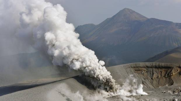 Aerial footage shows the increasingly active volcano Mount Shinmoe smoking on Wednesday afternoon.