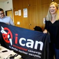 Beatrice Fihn, executive director of the International Campaign to Abolish Nuclear Weapons (ICAN), and coordinator Daniel Hogsta celebrate after winning the Nobel Peace Prize in Geneva on Friday. | REUTERS