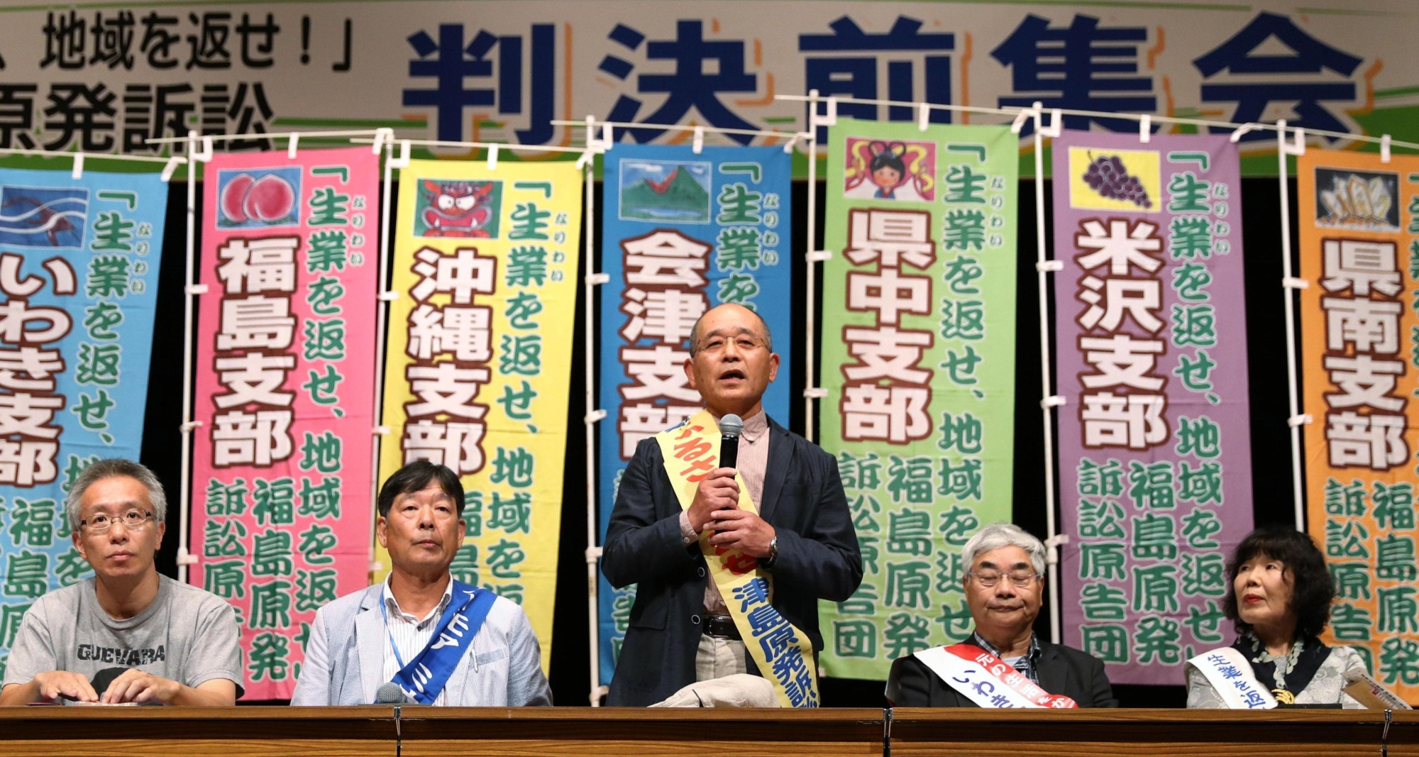 A man speaks on Tuesday in the city of Fukushima during a meeting of victims seeking damages from the government and Tepco over the 3/11 nuclear disaster. Later in the day, the court ruled in their favor. | KYODO