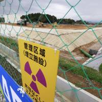 A new facility in the town of Okuma, Fukushima Prefecture, starts storing radioactive waste generated by the 2011 nuclear crisis on Saturday. | KYODO