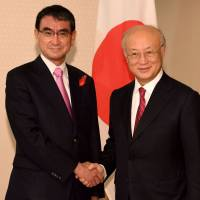 Foreign Minister Taro Kono (left) greets International Atomic Energy Agency Director-General Yukiya Amano prior to their talks at the Foreign Ministry in Tokyo on Tuesday. | AFP-JIJI