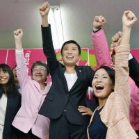 Constitutional Democratic Party candidate Kiyomi Tsujimoto celebrates victory with supporters in her Osaka No. 10 district after the day's Lower House election. | KYODO