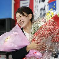 Shiori Yamao smiles Sunday in Nagakute, Aichi Prefecture, after winning a seat in the Aichi No. 7 district in the Lower House election. | KYODO