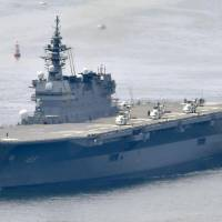 U.S. President Donald Trump is considering making an inspection of the Maritime Self-Defense Force helicopter carrier Izumo, seen in this file photo, during his visit to Japan next month, according to sources. | KYODO