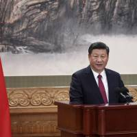 Chinese President Xi Jinping gives a speech during the introduction of the Communist Party of China's Politburo Standing Committee in Beijing's Great Hall of the People on Wednesday. | AFP-JIJI