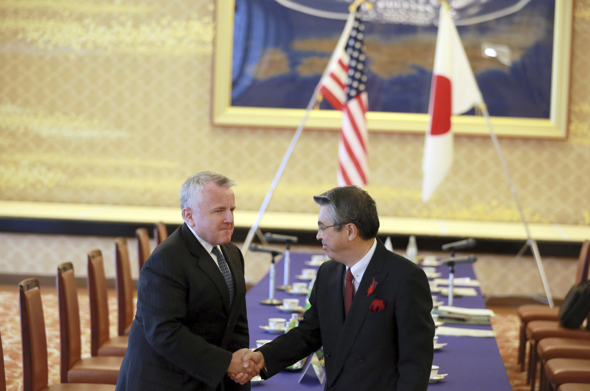 U.S. Deputy Secretary of State John Sullivan and Deputy Foreign Minister Shinsuke Sugiyama shake hands prior to their meeting at Iikura Guesthouse in Tokyo on Tuesday. | AP