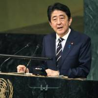 Prime Minister Shinzo Abe delivers a speech at the U.N. General Assembly in New York on Sept. 20. A draft anti-nuclear resolution recently proposed by the Abe government to the general assembly was dramatically watered down under diplomatic pressure from the United States, government sources have revealed.  kyodo