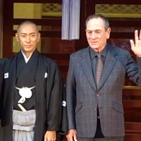 Kabuki actor Ichikawa Ebizo and U.S. actor and director Tommy Lee Jones wave during a news  conference at a Kabuki event at Kabukiza Theatre as part of the 30th Tokyo International Film Festival in Tokyo.