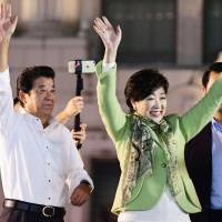 Nippon Ishin no Kai leader Ichiro Matsui waves to voters in Osaka with Kibo no To (Party of Hope) leader Yuriko Koike on Oct. 14 during campaigning for the Lower House election. | KYODO