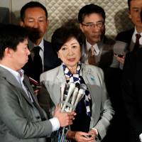 Tokyo Gov. Yuriko Koike, who is also head of the Kibo no To party, and Democratic Party leader Seiji Maehara, speak to reporters after their talks in Tokyo on Thursday. | REUTERS