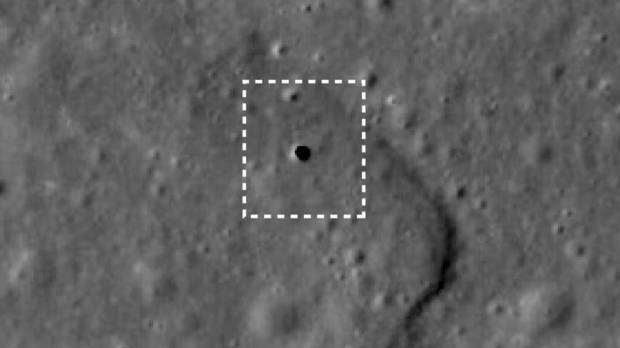 This undated satellite photo taken by the lunar orbiter Kaguya shows a 50-meter hole on the moon's surface that leads to a 50-km-long cave.