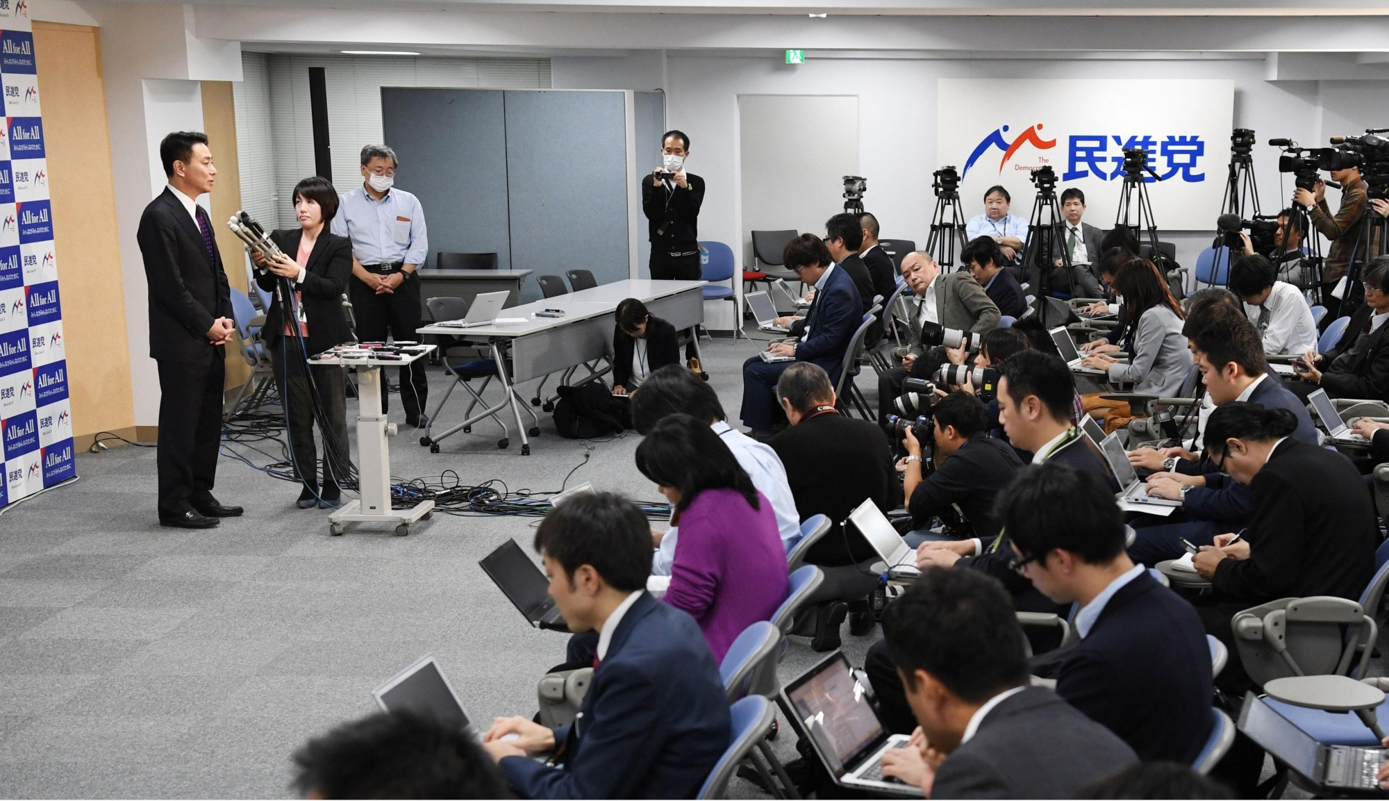 Seiji Maehara answers questions from reporters at the Democratic Party's headquarters in Tokyo on Monday. | KYODO