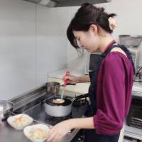 A woman in the city of Shizuoka cooks a meal kit from Yoshikei Kaihatsu K.K. on Sept. 11. | KYODO