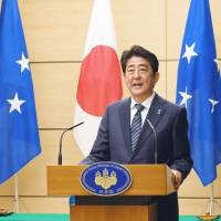Visiting Micronesian President Peter Christian and Prime Minister Shinzo Abe hold a joint news conference following their talks Wednesday at the Prime Minister's Office in Tokyo.   KYODO