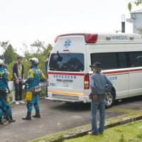 An ambulance arrives near the spot where 4-year-old Renki Fukumi was found safe in a forest in Ito, Shizuoka Prefecture, on Monday. | KYODO