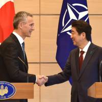 NATO Secretary-General Jens Stoltenberg shakes hands with Prime Minister Shinzo Abe following their joint new conference at Abe's official residence in Tokyo on Tuesday. | AFP-JIJI