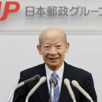 Taizo Nishimuro attends a 2003 news conference after assuming the post of Japan Post Holdings Co.'s president. KYODO