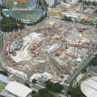 This aerial photo taken on July 23 shows the construction site for the new National Stadium in Tokyo's Shinjuku Ward. | KYODO