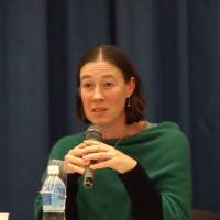Alexandra Devine, a senior research officer at the Nossal Institute for Global Health in Australia, speaks at a symposium on sports for athletes with disabilities in Tokyo on Friday. | MIZUHO AOKI