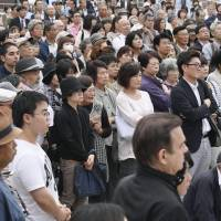 Voters gather and listen to a speech made by a candidate for the Oct. 22 election in the city of Matsudo in Chiba on Wednesday. | KYODO