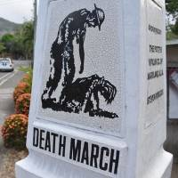 A monument commemorating the notorious 1942 Bataan Death March, in which U.S. and Filipino prisoners of war were forced by the Imperial Japanese Army to march more than 100 km to a prison camp on the Bataan Peninsula in the Philippines during World War II, stands beside a street in Mariveles, Philippines. | KYODO