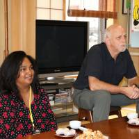 Scott Taylor, director of the Department of Community Justice of Multnomah County in Oregon, and Lusanne Green, association coordinator of the International Community Corrections Association in Ohio, listen to the experiences of Japanese volunteer probation officers on Sept. 12 at a Buddhist temple in Tokyo. | KYODO