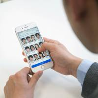 A service offered by Tokyo-based Kaonavi Inc. links photos of company employees with their online profiles for quick viewing. | KAONAVI INC. / VIA KYODO