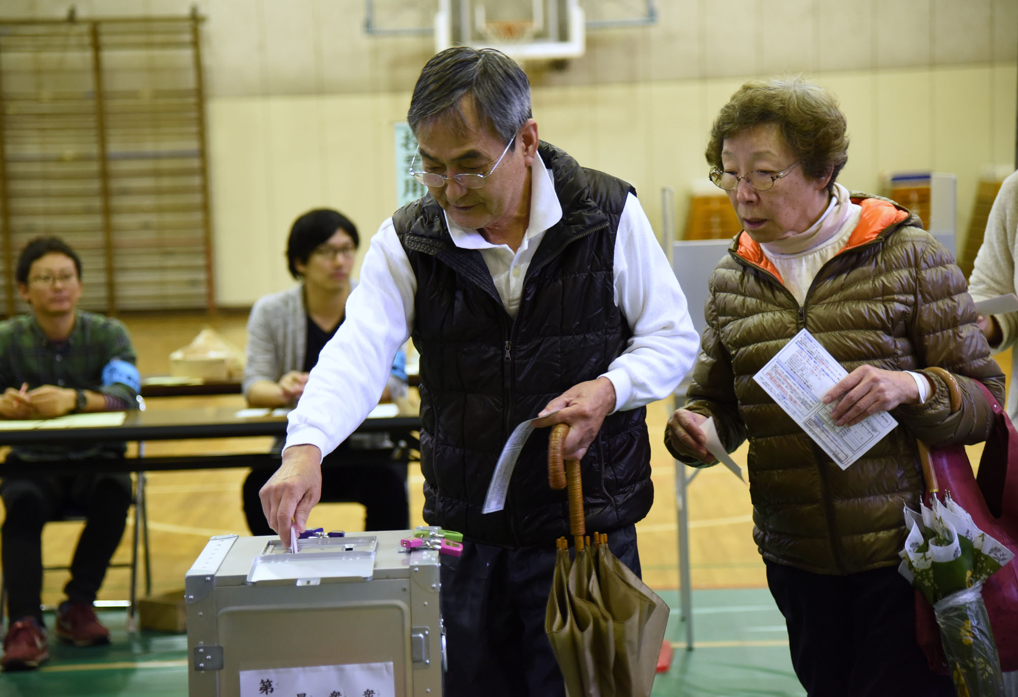People cast ballots in the Lower House election at a polling station in Minato Ward, Tokyo, on Sunday. | SATOKO KAWASAKI