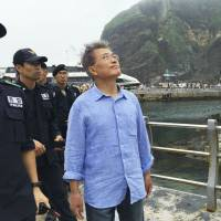 Moon Jae-in, then former leader of the Minjoo Party of Korea, visits Takeshima in July 2016 before being elected president of South Korea, which controls and calls the island Dokdo. | YONHAP NEWS AGENCY / VIA KYODO