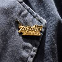 Ippudo's badge reads 'zuzutto' (slurping sound of noodles), a phrase it aims to popularize. | YOSHIAKI MIURA