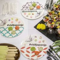 Snacks are served on plates featuring the hashtag #visitjapanjp during an event on Monday celebrating the launch of the Japan National Tourism Organization's new Instagram account. | JAPAN NATIONAL TOURISM ORGANIZATION