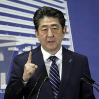Prime Minister Shinzo Abe speaks at the Liberal Democratic Party's headquarters in Tokyo on Oct. 23. | BLOOMBERG