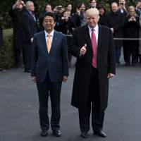 U.S. President Donald Trump and Prime Minister Shinzo Abe at the White House on Feb. 10. | AFP-JIJI