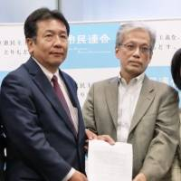 Yukio Edano (left), leader of the newly established Constitutional Democratic Party of Japan, receives a set of policy requests from Jiro Yamaguchi, a Hosei University professor known as a liberal critic, on Wednesday at the Diet. | KYODO
