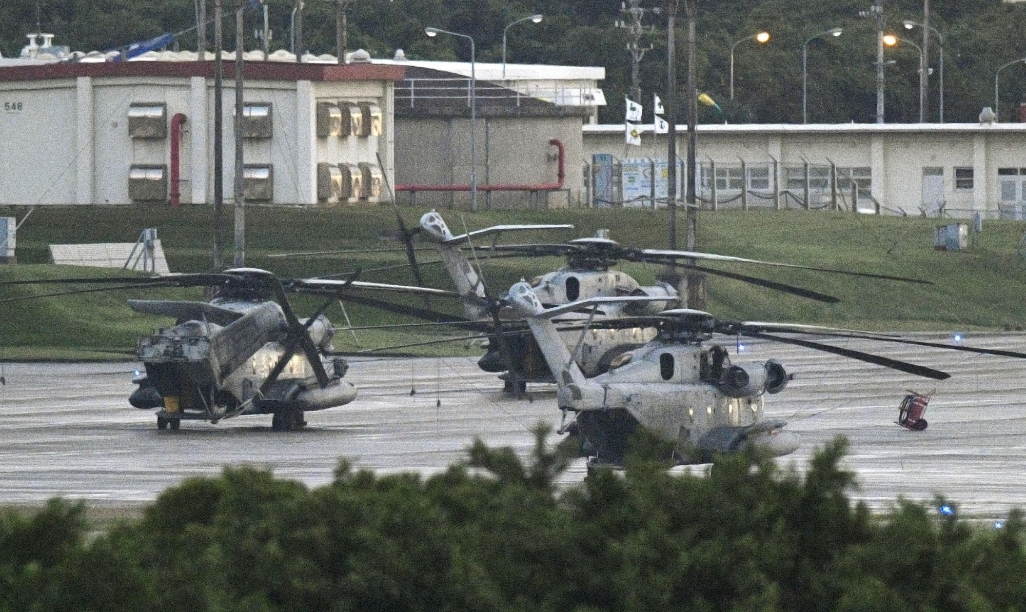 CH-53E helicopters are seen at U.S. Marine Corps Air Station Futenma in Ginowan, Okinawa Prefecture, on Tuesday. The U.S. Marine Corps said it will resume flight operations of the helicopters on Wednesday. | KYODO