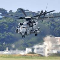 A U.S. Marine Corps CH-53E helicopter takes off from Air Station Futenma in Ginowan, Okinawa Prefecture, on Wednesday. | KYODO
