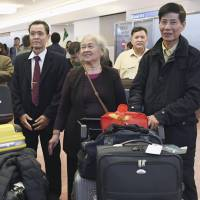 Vietnamese who were fathered by Japanese soldiers who remained in what is now Vietnam after World War II arrive at Tokyo's Haneda airport on Oct. 18. | KYODO