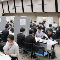 Manpower agency Recruit Staffing Co. and Litalico Inc., a job and education assistance service provider for people with disabilities, arrange job interviews in Tokyo on Sept. 15. | KYODO
