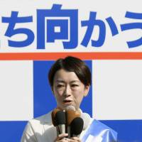 Independent candidate Shiori Yamao, who has been tarnished by an alleged extramarital affair, speaks in Owariasahi, Aichi Prefecture, on Oct. 10, the first day of campaigning for Sunday's general election. | KYODO