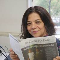 Swoop scoop: Deborah Krisher-Steele holds a copy of the last edition of The Cambodia Daily, which shows the country's main opposition leader, Kem Sokha, being arrested by police in a surprise raid. | COURTESY OF DEBORAH KRISHNER-STEELE