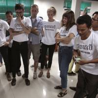 Last post: Editorial staff at The Cambodia Daily look at the layout of the final edition on  Sept. 3 at the paper's offices in Phnom Penh. About half the Daily's 30 editorial staff were Cambodian, with the other half drawn to the nation from around the world. | AP