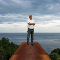 Home by the sea: Artist Hiroshi Sugimoto stands atop a 70-meter rectangular chamber made from CorTen weathering steel that starts underground and ends up as a sheer drop overlooking the ocean at the Enoura Observatory, Kanagawa Prefecture. It is angled to capture the winter solstice. | ROB GILHOOLY