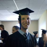 Two worlds: Samuel Tincher graduates college in the U.S. in 2014.  Born and raised in Japan by American parents, his Japanese schoolmates expected him to excel at 'Western' sports and English and do poorly at kanji.