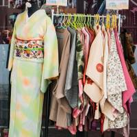 Used kimono on display at a second-hand store. | ISTOCK