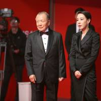 Welcome to Busan: Festival director Kang Soo-youn and co-founder and chairman Kim Dong-ho stand on the red carpet at this year's Busan International Film Festival on Oct. 12. | COURTESY OF BUSAN INTERNATIONAL FILM FESTIVAL