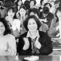 Case closed: Supporters clap after hearing of Mayumi Haruno's final court victory in her sexual harassment case 1992, three years after the landmark first ruling in her favor at the Fukuoka District Court.